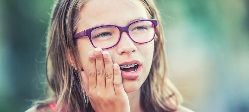 Болят зубы от брекетов